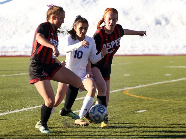 Aspen High School's Grace Romero, left, and teammate Maeve McGuire battle for the ball with Roaring Fork's Genesis Quintero during a girls soccer game on Tuesday, March 19, 2019, on the AHS turf. (Photo by Austin Colbert/The Aspen Times).