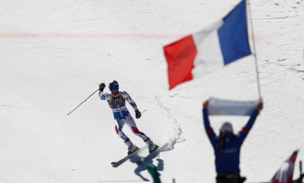 France's Alexis Pinturault celebrates winning an alpine ski, men's giant slalom, at the alpine ski, World Cup finals in Soldeu, Andorra, Saturday, March 16, 2019. (AP Photo/Gabriele Facciotti)