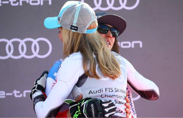 United States' Mikaela Shiffrin, left, hugs Switzerland's Wendy Holdener after and alpine ski, women's slalom, at the alpine ski, World Cup finals in Soldeu, Andorra, Saturday, March 16, 2019. (AP Photo/Gabriele Facciotti)
