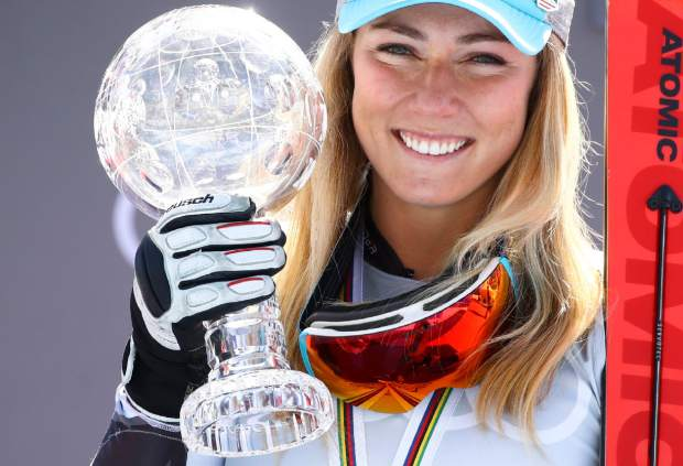 United States' Mikaela Shiffrin holds the women's World Cup slalom discipline trophy at the alpine ski, World Cup finals in Soldeu, Andorra, Saturday, March 16, 2019. (AP Photo/Gabriele Facciotti)