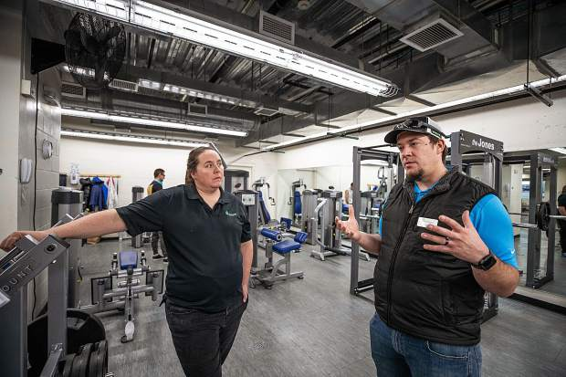 Aspen Rec Center employees Erin Hutchins and Cory Vander Veen stand and discuss further plans in the newly renovated weight-lifting room in the ARC on Wednesday.