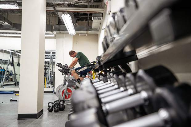 A cyclist pedals on one of the stationary bikes in the newly remodeled weight lifting area in the Aspen Rec Center on Wednesday.