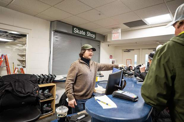 Aspen Rec Center employee Robert Skorr helps customers rent skates on Wednesday afternoon at the new reception desk area on the lower level.