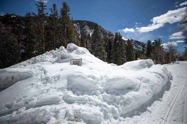 Snow piled up at the Maroon Creek Road closure by T-Lazy 7 Ranch. The snow depth and avalanche debris covering the road further up the valley will make it challenging to open the road at the annual target date of May 15, according to Pitkin County and Forest Service officials.