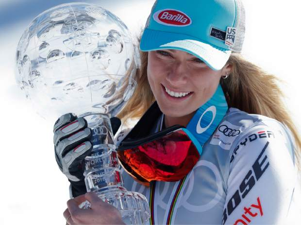 Mikaela Shiffrin holds the women's World Cup overall trophy at the alpine ski World Cup finals in Soldeu, Andorra earlier this month.