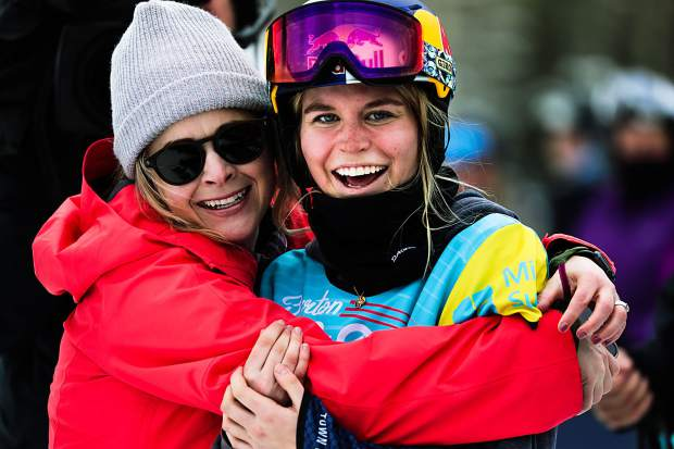 Maddie Mastro celebrates with her friend, Anne Jackson, after her winning run during the Women's Halfpipe Finals during the Burton US Open Snowboarding Championships Saturday, March 2, in Vail, Colo. Mastro threw down a double crippler for her winning run.
