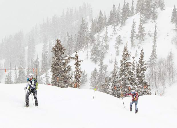 Summit County ski mountaineering race partners Sam O'Keefe, at left, of Breckenridge and Summit Daily photographer Hugh Carey, ascend toward top of Aspen Highlands Resort during the Audi Power of Four ski mountaineering race on March 2, near Aspen. The annual ski mountaineering race brought hundreds of athletes to scale nearly 11 thousand feet of vertical climbing over the course of 25 miles, summiting all four Aspen area ski resorts.