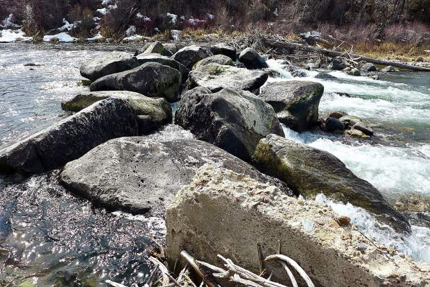 The rock weir across the Roaring Fork River on Tuesday, known as Anderson Falls. The Robinson Ditch Co. re-worked the boulder structure on Monday to repair damage from an ice flow in January, but the repairs appear to have made navigating the structure in a boat harder to do.