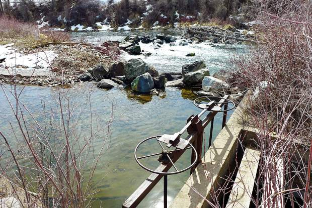 A view of the headgate on the Robinson Ditch and the boulder structure in the Roaring Fork River that maintains the grade of the river so water can reach the headgate.The water that reaches the headgate does not come directly off of the diversion structure, but enters a channel just upstream.