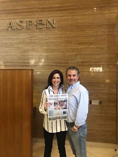 Judi and Alan Altman show their Aspen Times in front of the Aspen Cafe at the Ski Dubai indoor ski mountain in Dubai, United Arab Emirates, earlier this month.