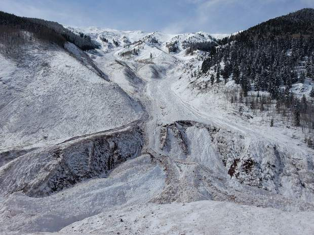 An avalanche dumped tons of snow and debris in the Conundrum Creek Valley floor beneath the area known as Five Fingers. The massive avalanche started at Highlands Ridge at the top.