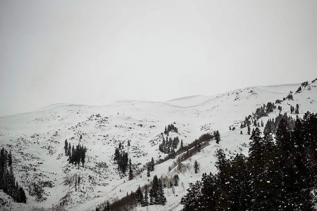 The veiw from the Conundrum Creek Valley floor on Tuesday shows that an avalanche scoured the Five Fingers path. A lage cornice is still visible on Highlands Ridge.