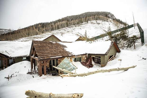 A house in Conundrum Creek Valley suffered some exterior damage from a massive avalanche last weekend, but a protective wall prevented catastrophic damage.