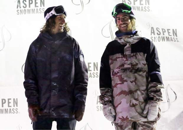 Breck's Eric Willett, left, stands on the podium after winning the snowboard portion of the KickAspen Big Air contest on Friday, March 22, 2019, at the base of Aspen Mountain. To his right is third-place finisher Eric Beauchemin. (Photo by Austin Colbert/The Aspen Times).