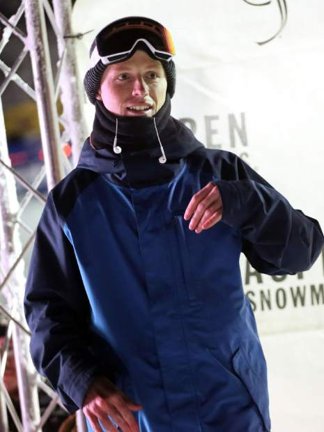 Robert Pettit stands on the podium after taking second in the snowboard portion of the KickAspen Big Air contest on Friday, March 22, 2019, at the base of Aspen Mountain. (Photo by Austin Colbert/The Aspen Times).