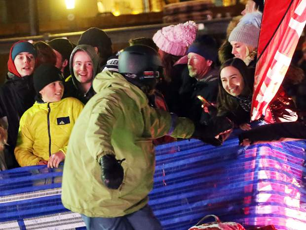 Shane Sherrano greets fans during the KickAspen Big Air contest on Friday, March 22, 2019, at the base of Aspen Mountain. (Photo by Austin Colbert/The Aspen Times).