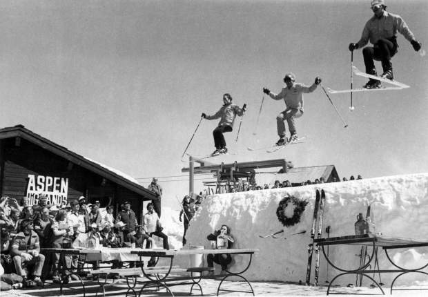 Members of the Aspen Highlands Ski Patrol jump over the Cloud Nine Restaurant dec on March 22, 1979, in a pcture that ran in The Aspen Times. The patrollers are (left to right): Kim Atkins,  note Chorzempa and Mac Smith.
