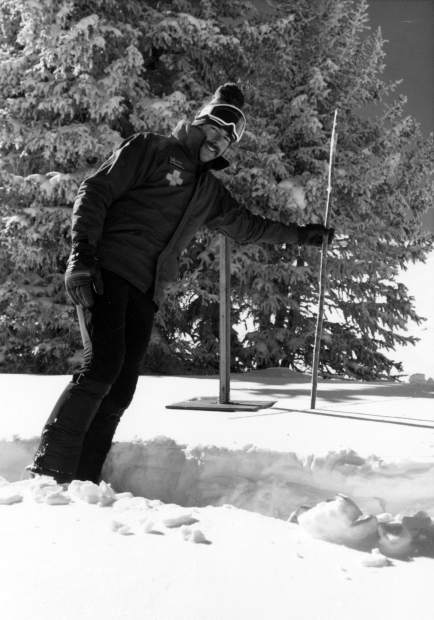 Ski patroller Mac Smith checks the snow depth at Aspen Highlands, circa 1975.