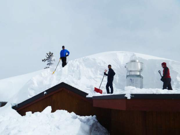 Workers shovel serious snow from the roof of Bonnie's on Aspen Mountain recently.