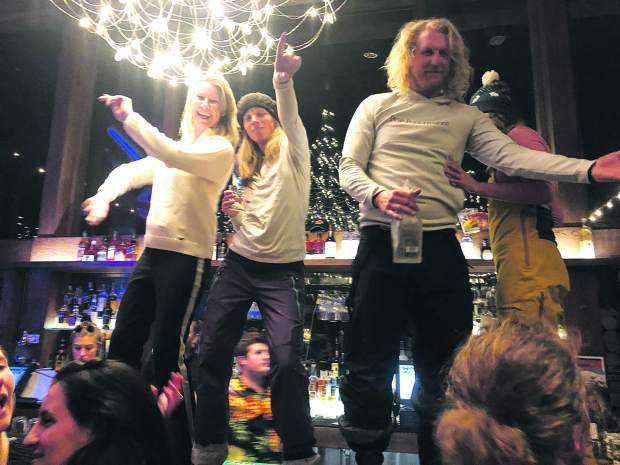 Partygoers groove atop the bar during Shlomo's après-ski.