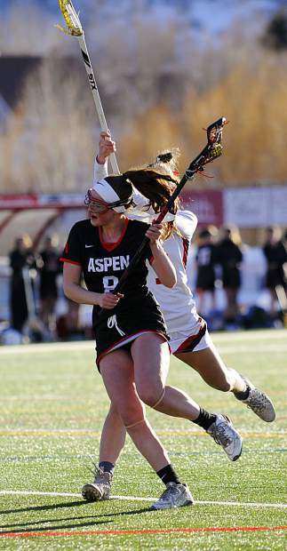 Aspen senior Charlotte Howie battles past Steamboat Springs senior Lucy Shimek on Wednesday, March 20, 2019, at Gardner Field in Steamboat Springs. The Skiers won 20-5.