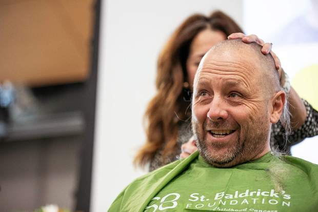 Basalt High School teacher Brent Hayes shaves his head at Basalt High School to honor Anna Cunningham, a BHS student battling Ewing sarcoma on Wednesday morning.