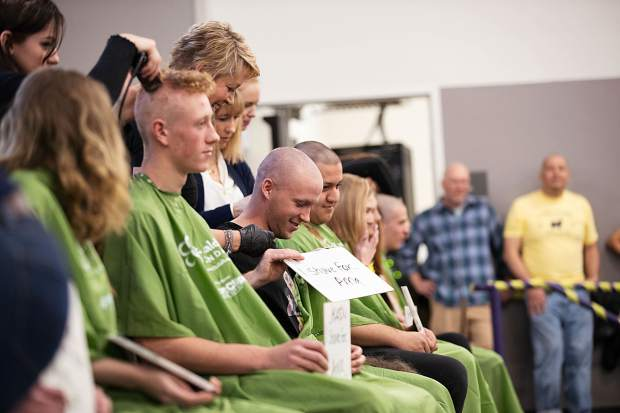 Hairdressers shave participants' heads Wednesday morning for the Basalt Bold & Bald fundraiser at Basalt High School.