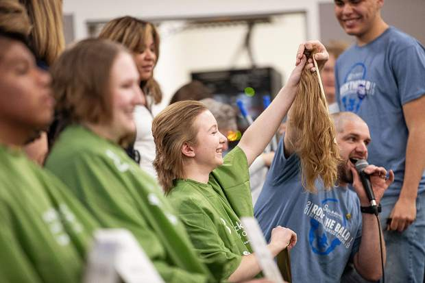 BHS senior Emily Northrup holds up her hair Wednesday morning during the Basalt Bold & Bald fundraiser.
