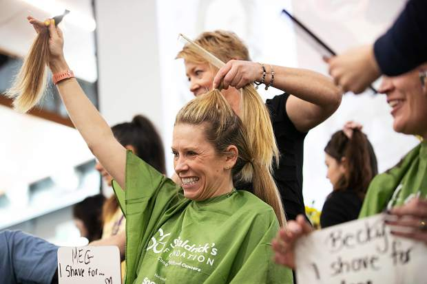 BHS assistant principal Megan Baiardo holds up her hair Wednesday morning for a St. Baldrick's fundraiser at Basalt High School.