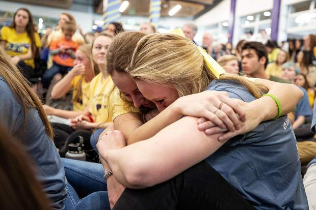 Emma Haag, right, and Lily Gillis embrace at Basalt High School on Wednesday morning during a fundraiser for St. Baldrick's Foundation and also honoring their classmate, Anna Cunningham, who is battling Ewing sarcoma.