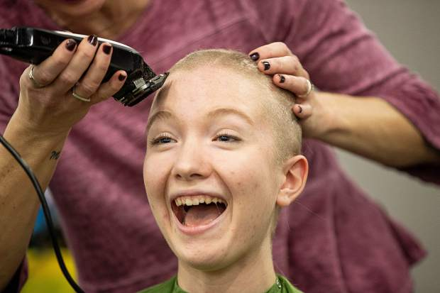 BHS senior, Emily Northrup gets her head shaved Wednesday morning for a St. Baldrick's fundraiser at Basalt High School on Wednesday morning.