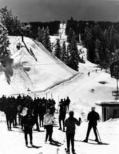 Skiers wait in a lift line at midway at Buttermilk in 1965. Buttermilk opened for the 1958-59 season.