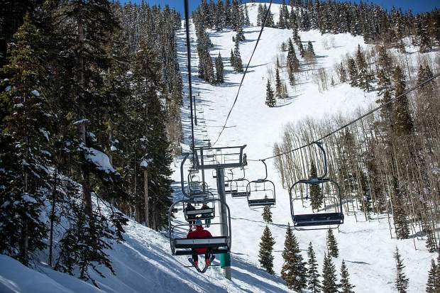 Lift riders make their way up Aspen Highlands on a quiet weekday. The steady addition of expert ski terrain has attracted more customers back to the ski area.