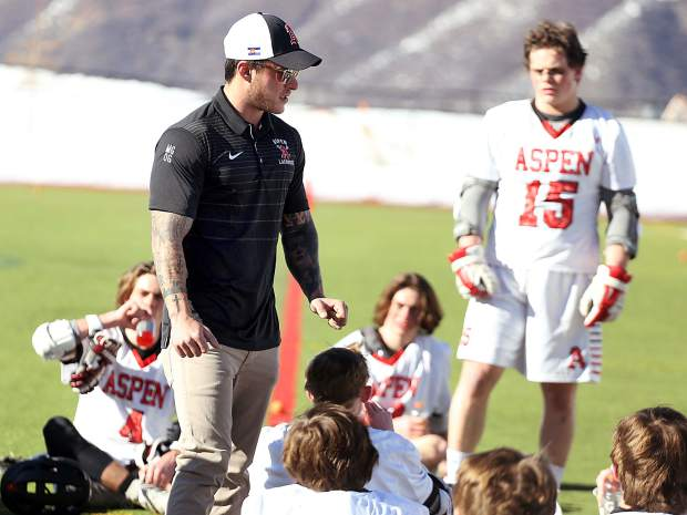 Aspen High School boys lacrosse coach Tommy Cox talks to the players at halftime of the game against Vail Mountain School on Wednesday, March 20, 2019, on the AHS turf. (Photo by Austin Colbert/The Aspen Times).