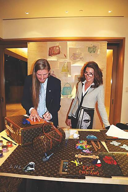 Louis Vuitton artist Logan Loiselle with Suzanne Redfield.