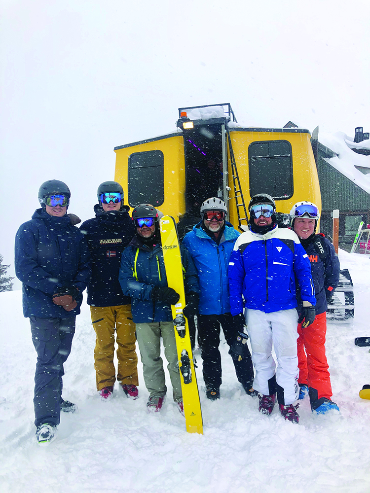 A half-dozen Aussies after a snowy outing with Aspen Mountain Powder Tours.