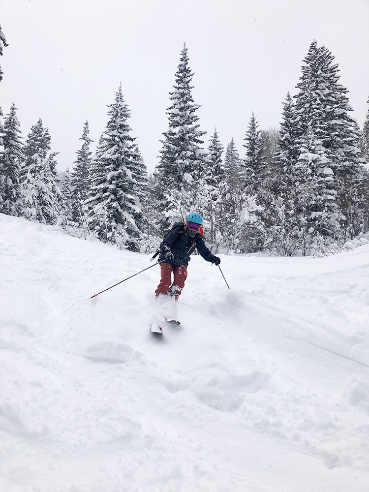 Aspen Mountain Powder Tours guide Debbie Kelly in the field on an especially deep day of skiing.