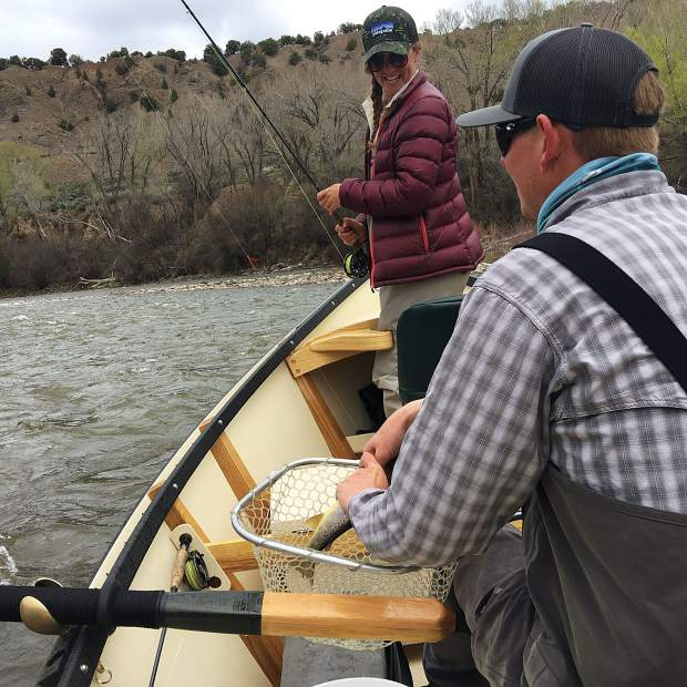 Local guide Brandon Soucie helps instruct Anna Stonehouse during a fly fishing trip down the Roaring Fork River last summer.