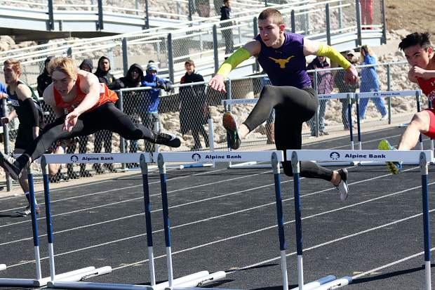 Basalt's Ben Williams competes in the 110-meter hurdles on Friday, March 15, at a track and field meet hosted by Rifle.