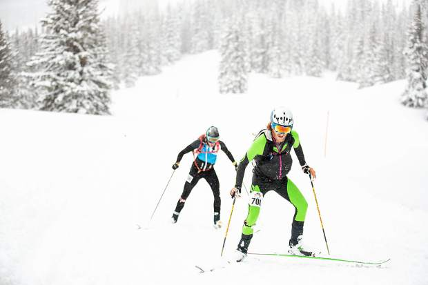 Cam Smith, front, and Tom Goth compete in the ski mountaineering race, Power of 4, on Richmond Ridge of Aspen Mountain on Saturday. Smith and Goth took second place.