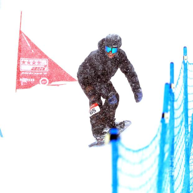 Aspen's Zach Hooper competes in the banked slalom on Sunday, March 24, 2019, at Snowmass Ski Area. (Photo by Austin Colbert/The Aspen Times).