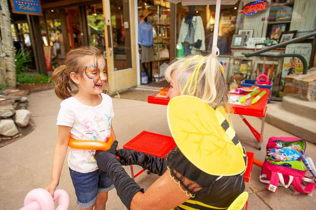 Sophia Duke, 5, gets a balloon belt for her sword from Dizzy Lizzy Friday evening for the Fridays on the Mall festivities in Snowmass.