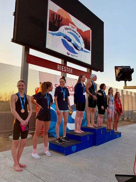 Aspen Swim Club's Lillie Boggs, far left, stands on the podium after taking eighth in the mile at the 2019 Four Corners sectional meet in Arizona over the weekend.