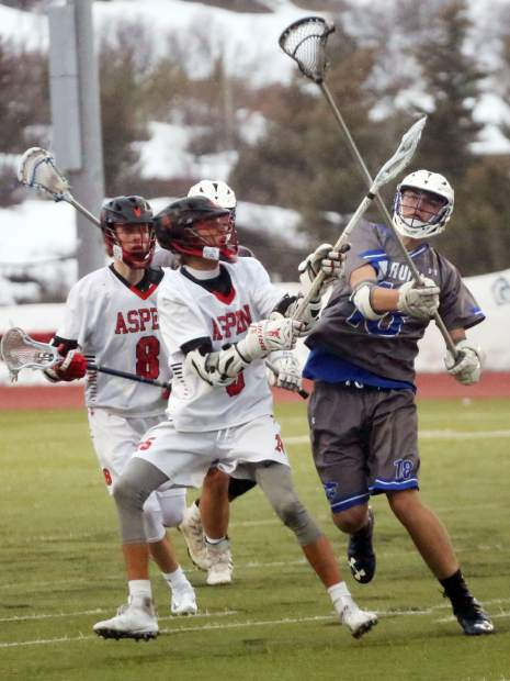 Players battle for the ball as the Aspen High School boys lacrosse team plays against Fruita Monument on Wednesday, April 3, 2019, on the AHS turf. Fruita won, 14-9. (Photo by Austin Colbert/The Aspen Times).