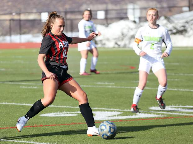 Aspen High School girls soccer player Grace Romero lines up a pass against Summit on Thursday, April 4, 2019, on the AHS turf. The Skiers won, 7-0. (Photo by Austin Colbert/The Aspen Times).