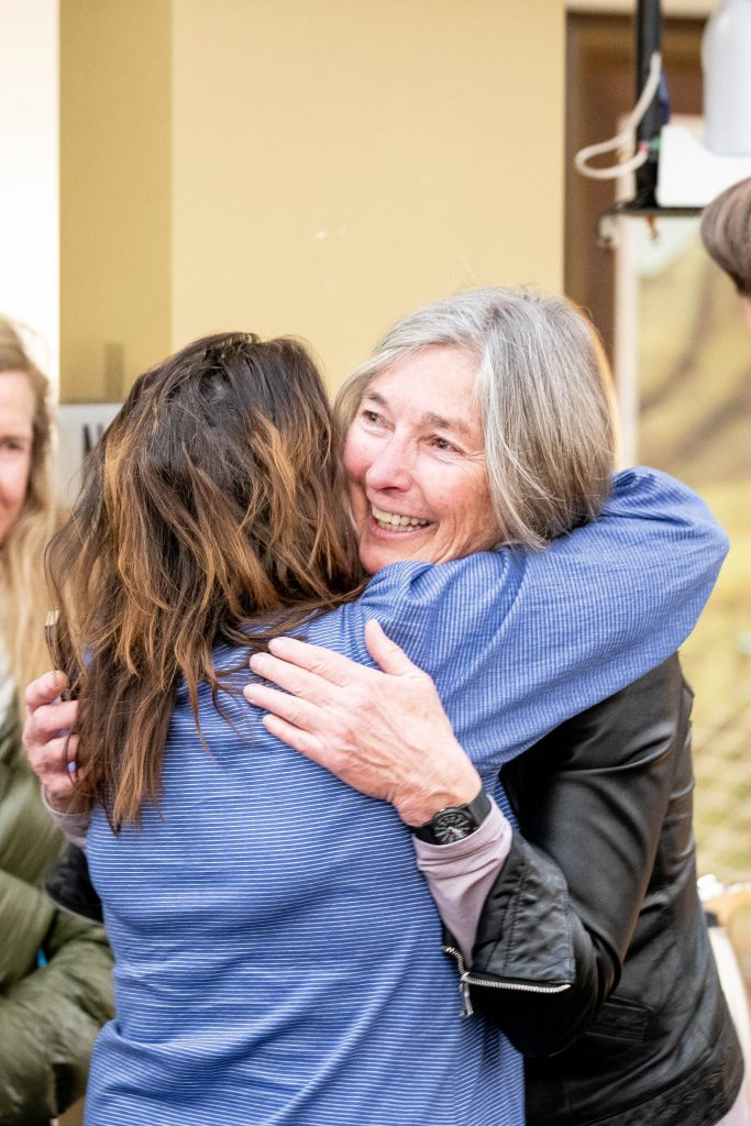 Ann Mullins, right, receives a big hug from Pitkin County Commissioner Patti Clapper after Mullins lost the runoff election for Aspen Mayor on Tuesday night in the basement of City Hall.
