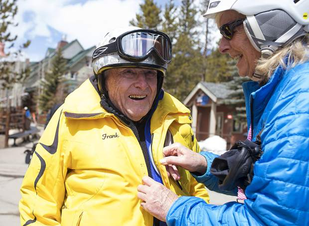 Frank Walter, 96, is buttoned up by Gini Patterson, executive director of Timberline Adult Day Services, on Thursday, April 4, at Keystone Resort.