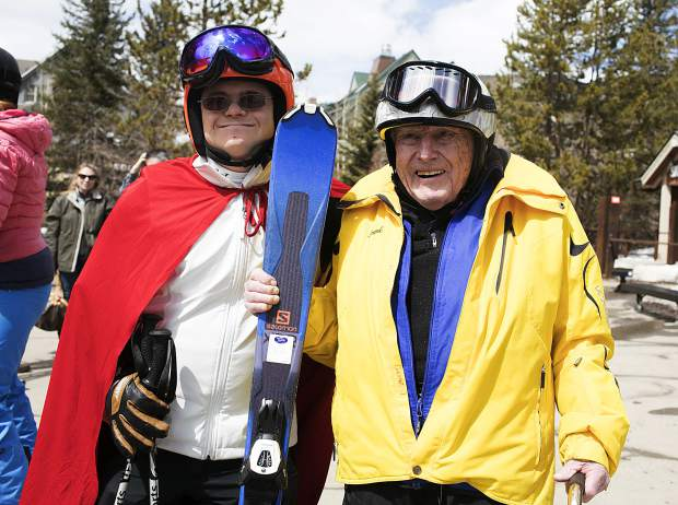 Frank Walter, 96, holds his skis and smiles alongside Summit County Special Olympics athlete Steven Kennedy on Thursday, April 4, at Keystone Resort.