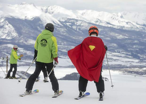 Summit County Special Olympics athlete Steven Kennedy skis with Breckenridge Outdoor Education Center guides on Thursday, April 4, at Keystone Resort.