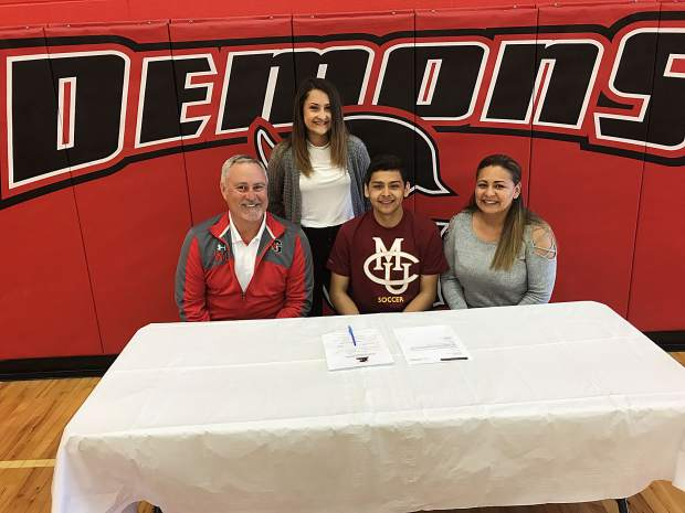 Glenwood Springs senior Leo Mireles center, signed his national letter of intent Wednesday afternoon at GSHS to play soccer at Colorado Mesa University. He is joined by his mother Maria (right), Glenwood Springs head coach Wayne Smith (left), and sister Sofia (back, center).